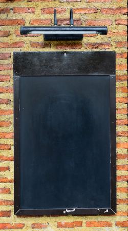 black board on brick wall photo