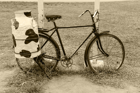steel  milk: bicycle with steel milk container at the back, Old style