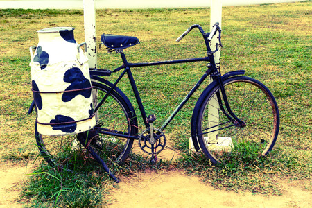 steel  milk: bicycle with steel milk container at the back