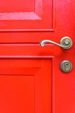 Close up of classic door handle on red door photo