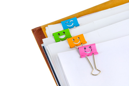dossier: Close up of documents with binder clips