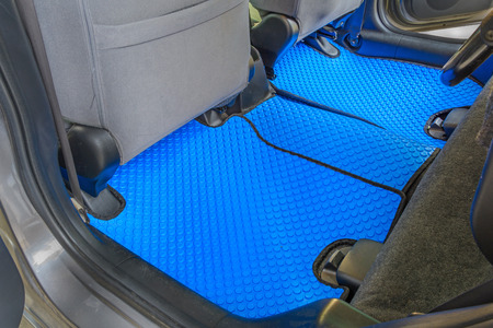 blue rubber car mats in car Standard-Bild