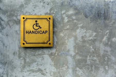 handicap symbol on cement background photo