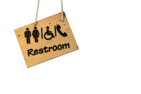 wooden toilet sign isolated on white photo