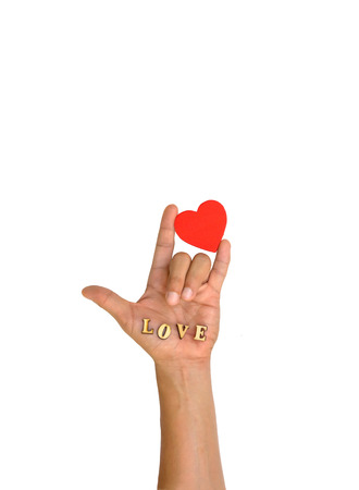 Hand with heart and letter LOVE on white background photo