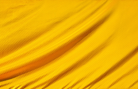 gold textured background: gold crumpled silk fabric textured background Stock Photo