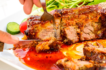 Close up of barbecued pork spare ribs photo