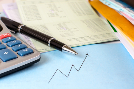 Account book with Calculator and documents. Finance and business graph photo