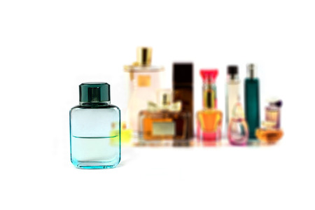 various perfumes collection isolated on white bavkground photo