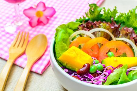 Close up of fresh salad on sackcloth photo