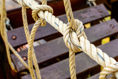 string together: Close up of rope with a knot Stock Photo