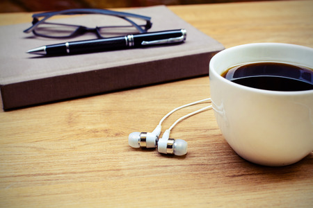 blank note book: Blank note book with coffee, glasses and headphone