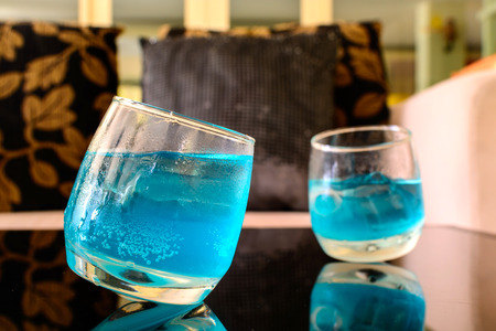 cocktail drinks: Blue cocktail in a glass in living room