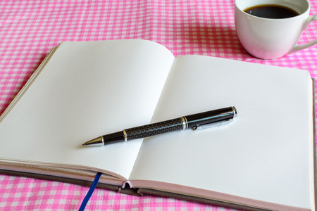 blank note book: Blank note book with cup of coffee Stock Photo