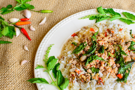 close up food: Close up of Rice topped with stir-fried pork and basil, Thai food Stock Photo
