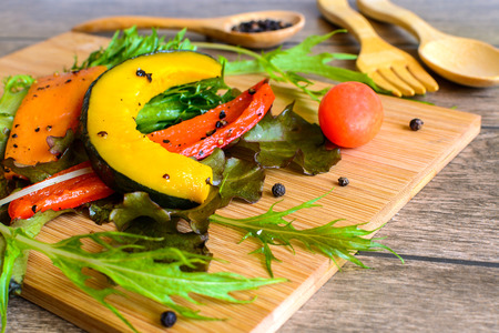 Ingredients of Fresh  salad on  wood cutting board photo