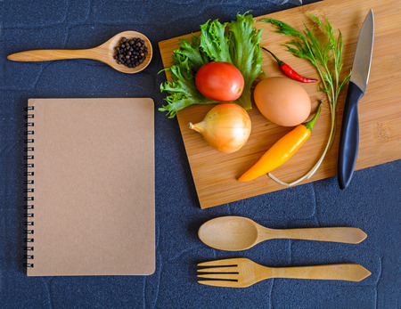 Food ingredient on wooden cutting board with note pad photo