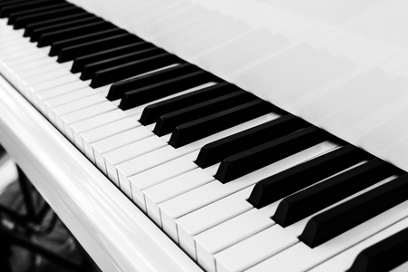 Close up of piano key on white piano Stock Photo