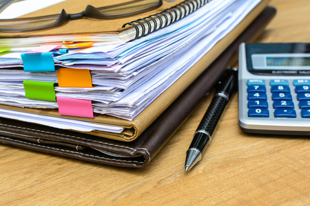 dossier: stack of folders and documents on office desk Stock Photo