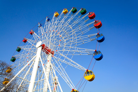 Colorful Giant ferris wheel against blue sky background photo