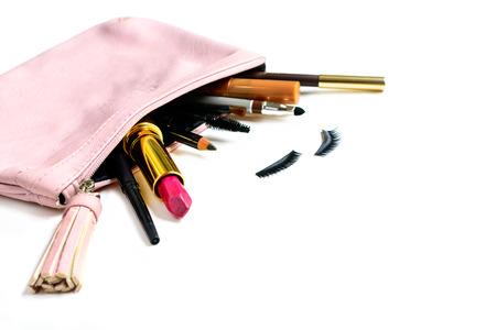 eye make up: make up bag with cosmetics and brushes isolated on white background