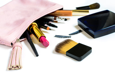 make up bag with cosmetics and brushes isolated on white background photo