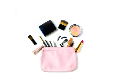 make up fashion: make up bag with cosmetics and brushes isolated on white background