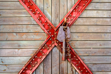 Old wooden and cross metal with rusty key  and chain textured background photo