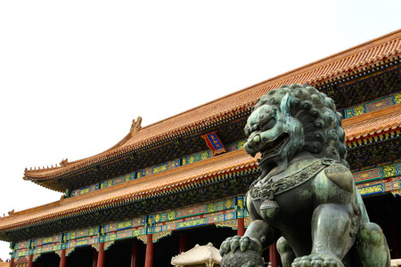 emperor of china: Copper lion in front of an ancient architecture in Forbidden city, Beijing China
