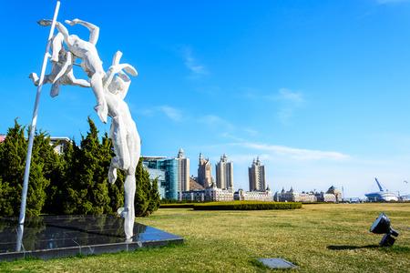 metre: Dalian, China - April 7, 2015 : sculpture at Xinghai square.The Square covers total area of 1.1 million square metre in Dalian, China