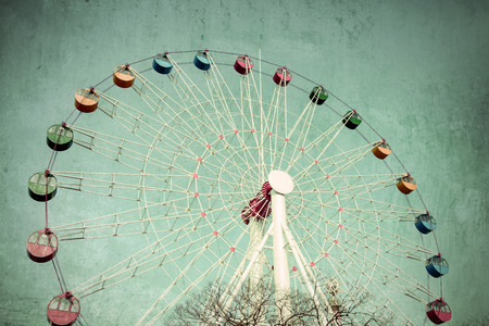 Colorful Giant ferris wheel against, Vintage style Imagens