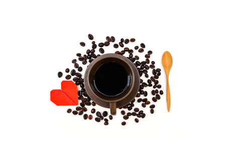 Cup of coffee with coffee beans and red heart isolated on white background photo