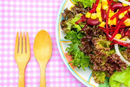 Close up of fresh salad on tablecloth photo