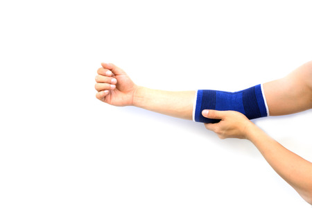 elbow bandage support: Arm with a elbow support isolated on white