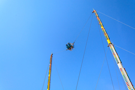 insecurity: Reverse Bungee with blue sky at amusement park