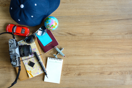 Outfit of traveler with copy space on wooden background, Travel concept 版權商用圖片