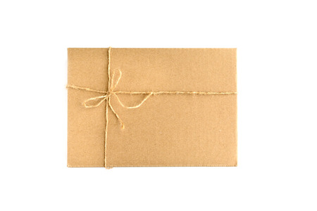 pack string: Brown paper parcel wrap delivery isolated on white background