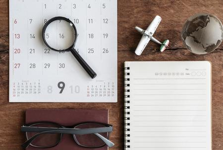 Open agenda en kalender met paspoort, Travel planning