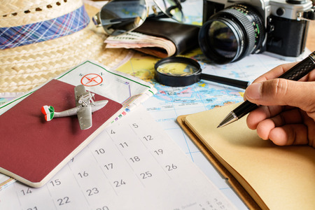 diary page: Diary and calendar with passport, Travel concept Stock Photo