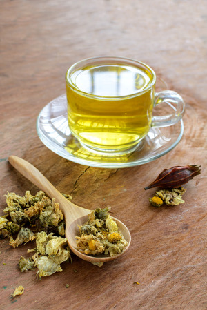 Chinese Chrysanthemum Tea on old wooden table