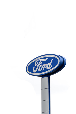 Chaingrai, Thailand - June 25, 2015: Large Ford logo sign isolated on white background, Ford is the second-largest U.S.-based automaker and the fifth-largest in the world Editorial