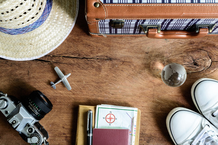 travel concept: Outfit of traveler on wooden background, Vintage style