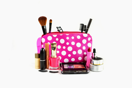 cosmetics collection: make up bag with cosmetics and brushes isolated on white