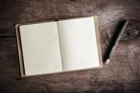 Open blank notebook on wooden table, Vintage tone Zdjęcie Seryjne
