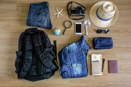 passport background: Outfit of traveler on old wooden background