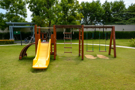 playground equipment: Playground with lawn at village Stock Photo