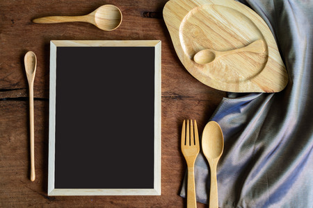 kitchen utensil: wooden utensil in kitchen on old wooden background with blackboard and copy space