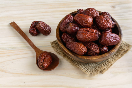 jujube fruits: Dried jujube fruits on wooden table