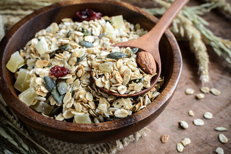 Oat and whole wheat grains flake in wooden bowl on wooden table Stock fotó