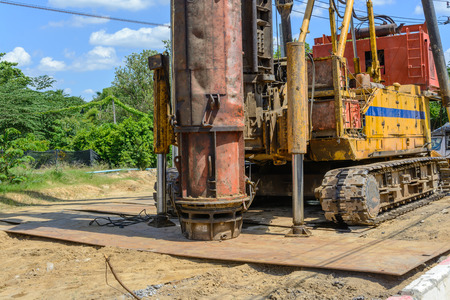 specialized job: hydraulic Foundation piles drilling machine on construction site